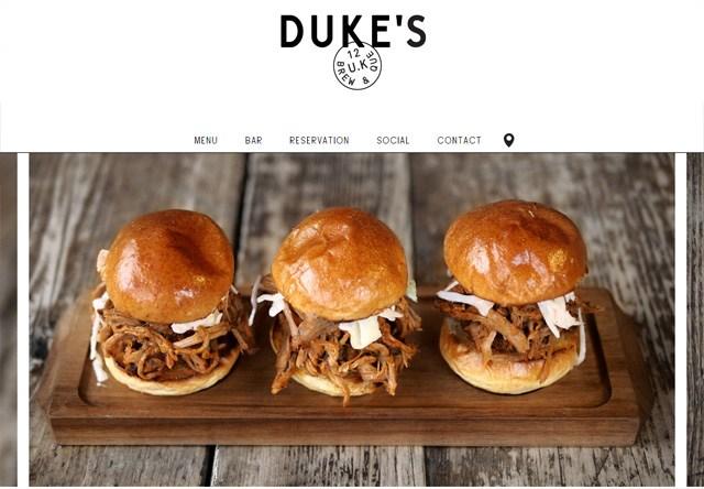 Image of a restaurant website: Duke's Brew & Que