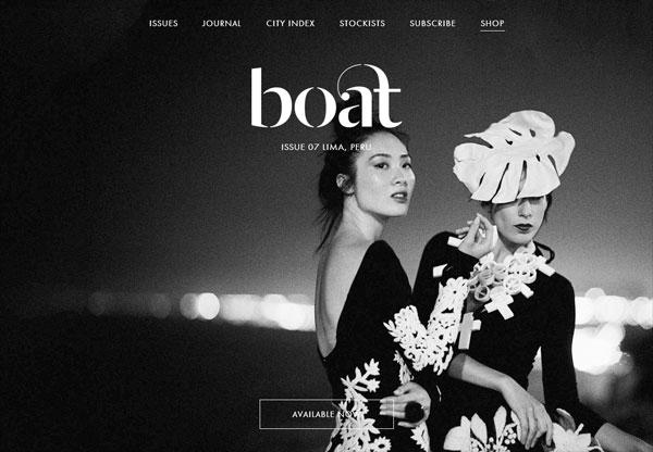 A screenshot of a black web design named Boat magazine