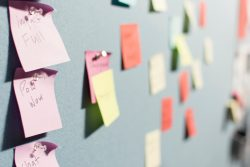 post-it notes on bulletin board
